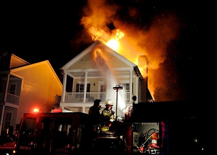 Firefighters from the Helena Fire Department battle a blaze at 148 Appleford Road in Helena on Jan. 12. (Reporter Photo/Jon Goering)